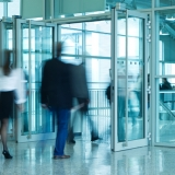 People Walking Through Entrance Door